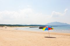 Seaside beach umbrella Stock Images