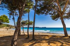 Seaside beach view in Peguera on Mallorca, Spain Balearic Islands. Beach in Paguera, Platja de Tora, Majorca island, Spain Mediterranean Sea royalty free stock photos