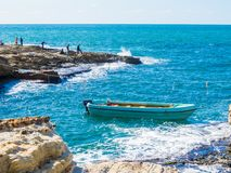 Seaside, Beirut, Lebanon. BEIRUT, LEBANON - NOVEMBER 2, 2017: Unidentified people fishing near the Pigeons` Rocks on Raouche royalty free stock photography