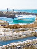 Seaside, Beirut, Lebanon. BEIRUT, LEBANON - NOVEMBER 2, 2017: Unidentified people fishing near the Pigeons` Rocks on Raouche stock image