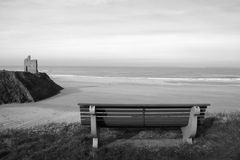 Seaside bench in black and white view Stock Photos