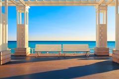 Seaside Bench on Mediterranean sea, empty. royalty free stock photos