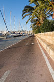 Seaside bicycling route. PALMA DE MALLORCA, BALEARIC ISLANDS, SPAIN - DECEMBER 22, 2015: Seaside bicycling route along the Mediterranean on a sunny day on Stock Photos