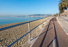 Seaside bicycling route. PALMA DE MALLORCA, BALEARIC ISLANDS, SPAIN - DECEMBER 22, 2015: Seaside bicycling route along the Mediterranean on a sunny day on Stock Photography