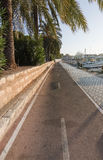 Seaside bicycling route. PALMA DE MALLORCA, BALEARIC ISLANDS, SPAIN - DECEMBER 22, 2015: Bicyclist point of view on seaside bicycling route along the Royalty Free Stock Photography