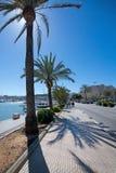 Seaside biking route with marina and palm trees. PALMA DE MALLORCA, BALEARIC ISLANDS, SPAIN - APRIL 13, 2016: Seaside biking route with marina and palm trees on Stock Images