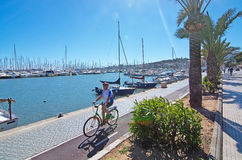 Seaside biking route with marina and palm trees. PALMA DE MALLORCA, BALEARIC ISLANDS, SPAIN - APRIL 13, 2016: Seaside biking route with marina and palm trees on Royalty Free Stock Photography