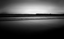 Seaside in Black and White. A unique, smooth, and minimalistic black and white view of the seaside after dawn Stock Photos