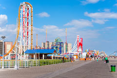 Seaside boardwalk and amusement parks in Coney Island, New York Stock Photography