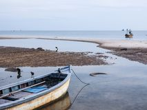 Seaside boats. Small fishing boats in the seaside at sunset Royalty Free Stock Photo