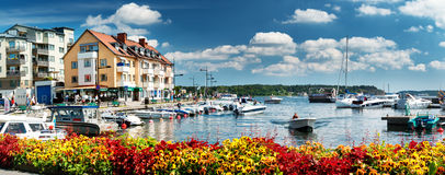 Seaside with boats at Vaxholm island. VAXHOLM, SWEDEN - JUNE 25, 2016: Cruise boats at little cosy island Vaxholm near Stockholm Royalty Free Stock Photos