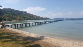 Seaside. The bridge stretches out to sea Royalty Free Stock Images