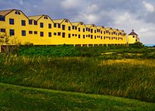 Seaside building and grassland Stock Photos