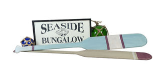 Seaside Bungalow Sign with Oars and Floats. Seaside Bungalow Sign with Boat Oars and Glass Floats - path included Royalty Free Stock Images