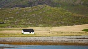 Seaside cabin in beautiful landscape Stock Image