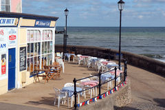 Seaside Cafe empty outside seating. Stock Images