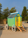 Seaside changing room bath car hut with wooden wheels in yellow and blue Stock Images