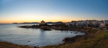 Seaside city at sunset Stock Photo