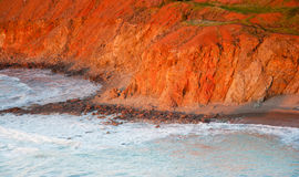 Seaside cliff bathed in afternoon light in Pomos, Cyprus Stock Photography