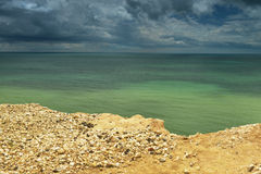 Seaside with cliff edge - green water Royalty Free Stock Image