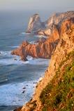 Seaside cliffs. Praia da Ursa beach cliffs in warm sunlight, viewed from  Cabo da Roca, in Portugal Stock Images