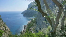Seaside cliffs of Monte Castiglione in Capri Italy. Medium wide high dynamic range shallow depth of field panning tracking slider shot of of the coastal cliffs stock video
