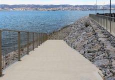 Seaside coast path with rocky beach Royalty Free Stock Photo