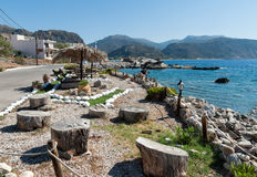 Seaside coastline decorated with art objects at Paleochora town on Crete island, Greece Royalty Free Stock Photography