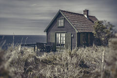 Seaside cottage at dusk Royalty Free Stock Photography