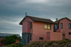 Seaside Cottage with Thatched Grass Roof stock images