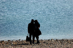 Seaside couples. Couples standed side by side on the beach on dalian Stock Images
