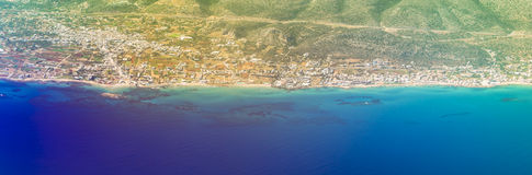 Seaside of Crete island, aerial view, Greece. Seaside view of resort Crete island with hotels and beaches, aerial view from flight altitude of aircraft. Sun Stock Photography