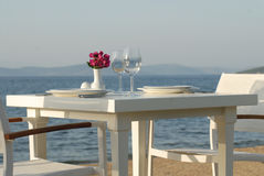 Seaside dinner table Stock Images