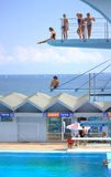 Seaside diving boards teens swimmers Royalty Free Stock Photography