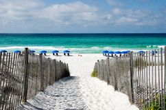 Seaside Florida in Walton County along the Emerald Coast. White sand footpath leading to a beach at Seaside Florida in Walton County. The panhandle of Florida is royalty free stock photo
