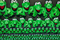 Seaside Frog Prizes. Stuffed frogs hang above boardwalk games as prizes Stock Photo