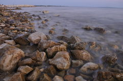 Seaside full of sharp rocks. On sunset Royalty Free Stock Images
