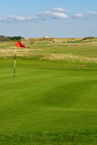 Seaside golf landscape. At Falsterbo, Sweden in October. Putting green with sand dunes behind Stock Photos