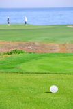 Seaside golfing. Golf course by beautiful ocean Stock Image
