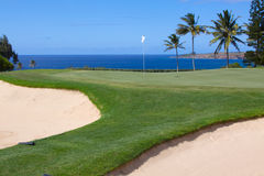 Seaside Green. A green sitting on the edge of the pacific ocean forms a beatiful golf hole stock photos