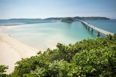 Seaside green forest and bridge. Tsunoshima Ohashi bridge and sandy beach over the green forest Royalty Free Stock Image