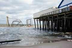 Seaside Heights NJ Post-Hurricane Sandy. A roller coaster sits in the Atlantic Ocean after Superstorm Sandy destroyed the pier upon which is sat Royalty Free Stock Photos