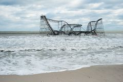 Seaside Heights NJ Post-Hurricane Sandy. A roller coaster sits in the Atlantic Ocean after Superstorm Sandy destroyed the pier upon which is sat Royalty Free Stock Images