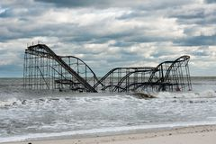 Seaside Heights NJ Post-Hurricane Sandy. A roller coaster sits in the Atlantic Ocean after Superstorm Sandy destroyed the pier upon which is sat Stock Image