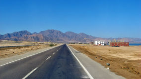Seaside highway. The coastal road - the sea and the mountains of Egypt Royalty Free Stock Image
