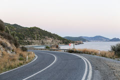Seaside highway curve Stock Photos
