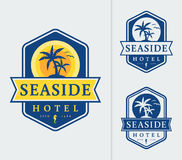 Seaside hotel logo emblems. Seaside hotel logo with palm trees and sun. Templates for color and monochrome versions. Vector emblems isolated on white background royalty free illustration