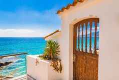 Seaside house with picturesque view of the blue sea. Holiday house with beautiful sea view on a sunny summer day Stock Photo
