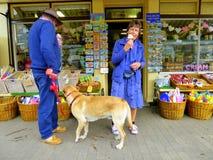 A couple eating ice creams outside a shop Stock Photos