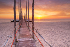 Seaside jetty at sunrise on Texel island, The Netherlands Stock Image